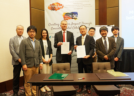 In the center, GÉANT's Mr. David West (left) and NICT VP Dr. Makoto Imase (right) after the MOU Signing Ceremony